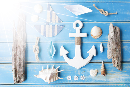 nautic: Flat Lay Of Chalkboard On Blue Wooden Background. Sunny Nautic Or Maritime Summer Decoration As Holiday Greeting Card.