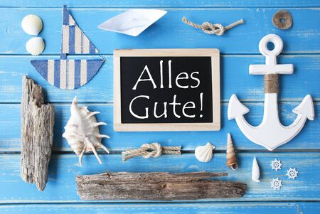 nautic: Flat Lay Of Chalkboard On Blue Wooden Background. Nautic Or Maritime Summer Decoration As Holiday Greeting Card. German Text Alles Gute Means Best Wishes