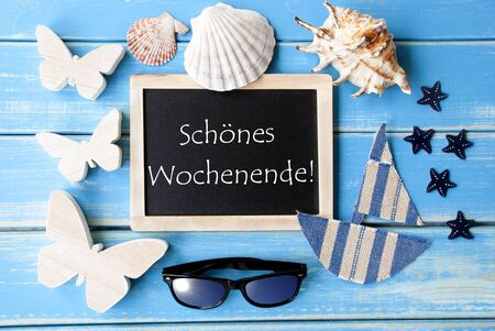wochenende: Flat Lay Of Chalkboard On Blue Wooden Background. Nautical Summer Decoration As Holiday Greeting Card. German Text Schoenes Wochenende Means Happy Weekend