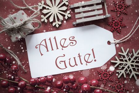 nostalgic christmas: Nostalgic Christmas Decoration Like Gift Or Present, Sleigh. Card For Seasons Greetings With Red Paper Background. German Text Alles Gute Means Best Wishes