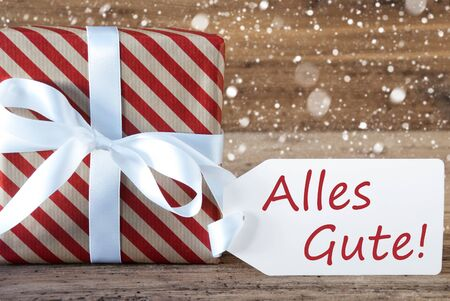best wishes: Christmas Gift Or Present On Wooden Background With Snowflakes. Card For Seasons Greetings. White Ribbon With Bow. German Text Alles Gute Means Best Wishes