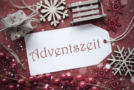 nostalgic christmas: Nostalgic Christmas Decoration Like Gift Or Present, Sleigh. Card For Seasons Greetings With Red Paper Background. German Text Adventszeit Means Advent Season