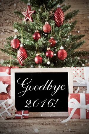 nostalgic christmas: Nostalgic Christmas Card For Seasons Greetings. Christmas Tree With Balls. Gifts Or Presents In The Front Of Wooden Background. Chalkboard With English Text Goodbye 2016