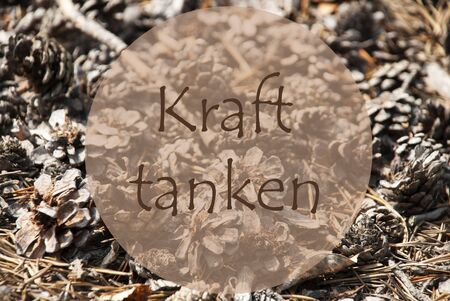 downtime: Texture Of Fir Or Pine Cone. Autumn Season Greeting Card. German Text Kraft Tanken Means Relax