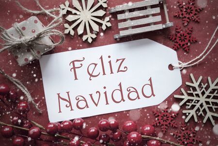 nostalgic christmas: Nostalgic Christmas Decoration Like Gift Or Present, Sleigh. Card For Seasons Greetings With Red Paper Background. Spanish Text Feliz Navidad Means Merry Christmas Stock Photo