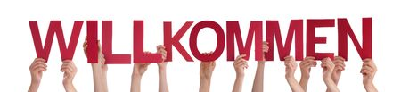 willkommen: Many Caucasian People And Hands Holding Red Straight Letters Or Characters Building The Isolated German Word Willkommen Which Means Welcome On White Background Stock Photo