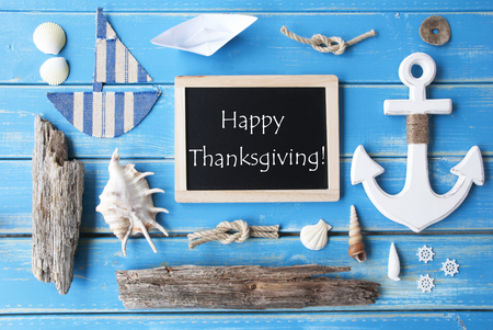 nautic: Flat Lay Of Chalkboard On Blue Wooden Background. Nautic Or Maritime Summer Decoration As Holiday Greeting Card. English Text Happy Thanksgiving Stock Photo