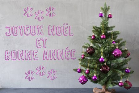 bonne: Christmas Tree With Purple Christmas Tree Balls. Gray Cement Or Concrete Wall For Urban, Modern Industrial Styl. French Text Joyeux Noel Et Bonne Anne Means Merry Christmas And Happy New Year Stock Photo