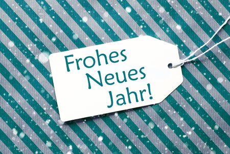 jahr: One Label On A Turquoise Striped Wrapping Paper. Textured Background With Snowflakes. Tag With Ribbon. German Text Frohes Neues Jahr Means Happy New Year Stock Photo