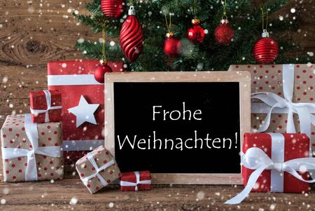 weihnachten: Colorful Card For Seasons Greetings. Christmas Tree With Balls And Snowflakes. Gifts Or Presents In The Front Of Wooden Background. Chalkboard With German Text Frohe Weihnachten Means Merry Christmas