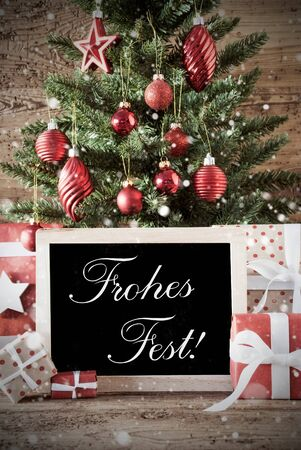 nostalgic christmas: Nostalgic Christmas Card For Seasons Greetings. Christmas Tree With Balls. Gifts Or Presents In The Front Of Wooden Background. Chalkboard With German Text Frohes Fest Means Merry Christmas Stock Photo