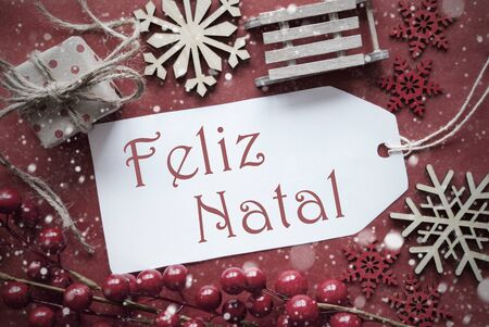 nostalgic christmas: Nostalgic Christmas Decoration Like Gift Or Present, Sleigh. Card For Seasons Greetings With Red Paper Background. Portuguese Text Feliz Natal Means Merry Christmas