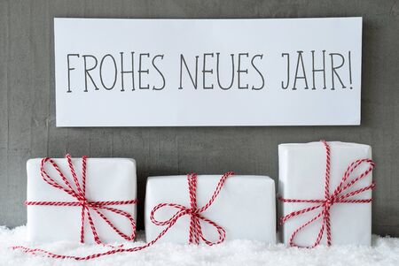 jahr: Label With German Text Frohes Neues Jahr Means Happy New Year. Three Christmas Gifts Or Presents On Snow. Cement Wall As Background. Modern And Urban Style. Card For Birthday Or Seasons Greetings.