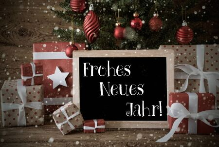jahr: Nostalgic Christmas Card For Seasons Greetings. Christmas Tree With Balls And Snowflakes. Gifts In The Front Of Wooden Background. Chalkboard With German Text Frohes Neues Jahr Means Happy New Year