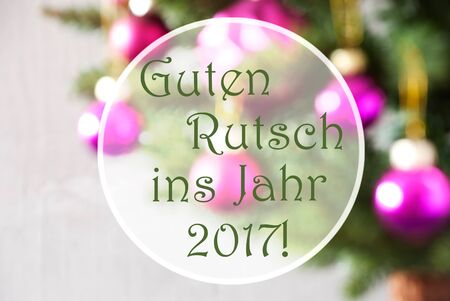 ins: German Text Guten Rutsch Ins Jahr 2017 Means Happy New Year 2017. Blurry Christmas Tree With Rose Quartz Balls. Close Up Or Macro View. Christmas Card For Seasons Greetings.