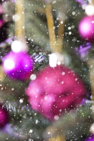 rose quartz: Vertical Blurry Christmas Tree With Rose Quartz Balls And Snowflakes. Close Up Or Macro View. Christmas Card For Seasons Greetings. Stock Photo