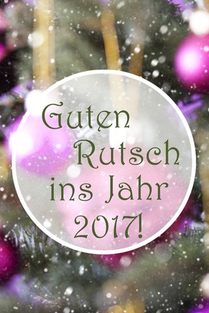 ins: German Text Guten Rutsch Ins Jahr 2017 Means Happy New Year 2017. Vertical Christmas Tree With Rose Quartz Balls. Close Up Or Macro View. Snowflakes For Winter Atmosphere. Stock Photo