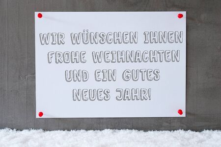 jahr: Label With German Text Wir Wuenschen Frohe Weihnachten Und Ein Gutes Neues Jahr Means Merry Christmas And Happy New Year. Urban And Modern Cement Wall As Background On Snow.