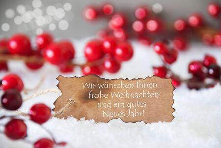 weihnachten: Burnt Label With German Text Wir Wuenschen Frohe Weihnachten Und Ein Gutes Neues Jahr Means Merry Christmas And Happy New Year. Red Decoration On Snow. Background With Bokeh Effect Stock Photo