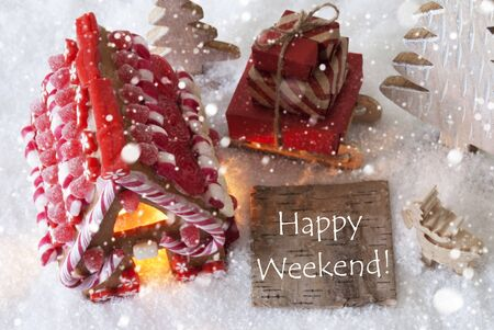 like english: Label With English Text Happy Weekend. Gingerbread House On Snow With Christmas Decoration Like Trees And Moose. Sleigh With Christmas Gifts Or Presents And Snowflakes. Stock Photo
