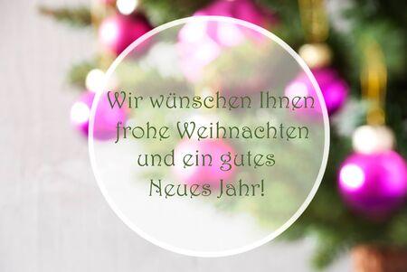 weihnachten: German Text Wir Wuenschen Frohe Weihnachten Und Ein Gutes Neues Jahr Means Merry Christmas And A Happy New Year. Christmas Tree With Rose Quartz Balls. Christmas Card For Seasons Greetings.