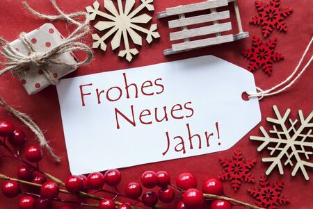jahr: Christmas Decoration Like Gift Or Present, Sleigh. Card For Seasons Greetings With Red Paper Background. German Text Frohes Neues Jahr Means Happy New Year