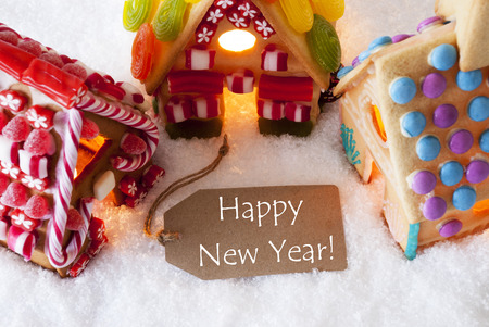 yea: Label With English Text Happy New Yea. Colorful Gingerbread House On Snow. Christmas Card For Seasons Greetings