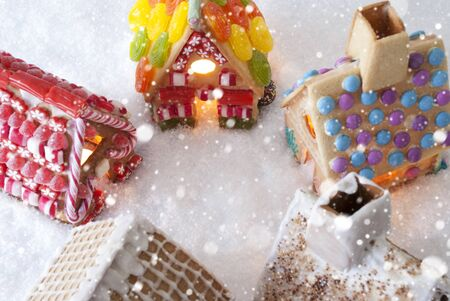 free image: Colorful Gingerbread Houses On Snow And Snowflakes. Christmas Card For Seasons Greetings. Copy Space For Advertisement Stock Photo