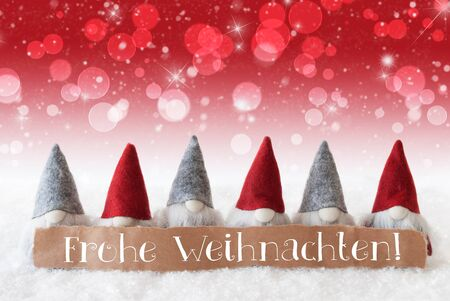 christmassy: Label With German Text Frohe Weihnachten Means Merry Christmas. Christmas Greeting Card With Red Gnomes. Sparkling Bokeh And Christmassy Background With Snow And Stars.