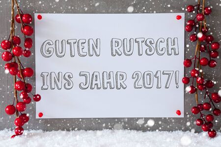 guten tag: Label With German Text Guten Rutsch Ins Jahr 2017 Means New Year 2017. Red Christmas Decoration On Snow. Urban And Modern Cement Wall As Background With Snowflakes.