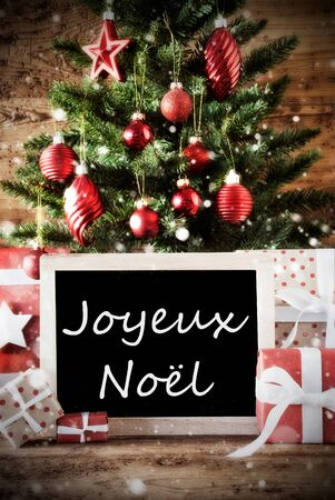 joyeux: Christmas Card For Seasons Greetings. Christmas Tree With Balls. Gifts Or Presents In The Front Of Wooden Background. Chalkboard With French Text Joyeux Noel Means Merry Christmas