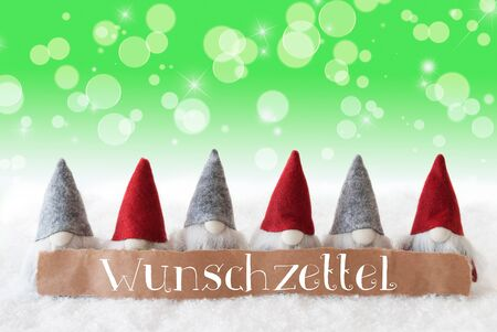Label With German Text Frohe Weihnachten Means Merry Christmas. Christmas Greeting Card With Gnomes. Sparkling Bokeh And Green Background With Snow And Stars. Stock Photo