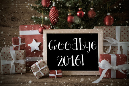nostalgic christmas: Nostalgic Christmas Card For Seasons Greetings. Christmas Tree With Balls And Snowflakes. Gifts Or Presents In Front Of Wooden Background. Chalkboard With English Text Goodbye 2016 For Happy New Year