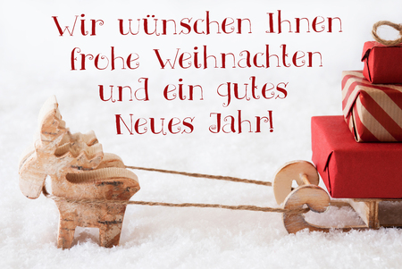 jahr: Moose Is Drawing A Sled With Red Gifts Or Presents In Snow. Christmas Card For Seasons Greetings. German Text Frohe Weihnachten Und Ein Gutes Neues Jahr Means Merry Christmas And Happy New Year