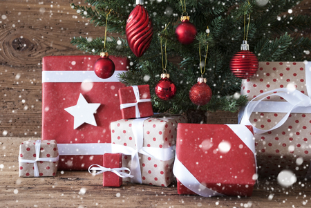 christmas tree presents: Christmas Tree With Gifts Or Presents In The Front Of Wooden Background. White Ribbon With Bow. Rustic Or Retro Style. Christmas Decoration Like Balls And Snowflakes