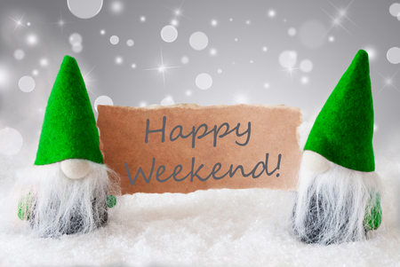 gnomos: Christmas Greeting Card With Two Green Gnomes. Sparkling Bokeh And Noble Silver Background With Snow. English Text Happy Weekend
