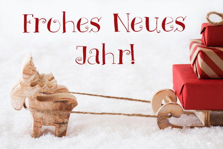 jahr: Moose Is Drawing A Sled With Red Gifts Or Presents In Snow. Christmas Card For Seasons Greetings. German Text Frohes Neues Jahr Means Happy New Year