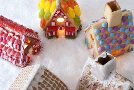 free image: Colorful Gingerbread Houses On Snow. Christmas Card For Seasons Greetings. Copy Space For Advertisement Stock Photo