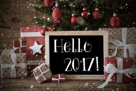 nostalgic christmas: Nostalgic Christmas Card For Seasons Greetings. Christmas Tree With Balls And Snowflakes. Gifts Or Presents In Front Of Wooden Background. Chalkboard With English Text Hello 2017 For Happy New Year