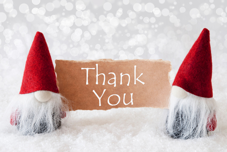 gnomos: Christmas Greeting Card With Two Red Gnomes. Sparkling Bokeh Background With Snow. English Text Thank You