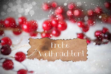 frohe: Burnt Label With German Text Frohe Weihnachten Means Merry Christmas. Red Christmas Decoration On Snow. Cement Wall As Background With Bokeh Effect And Snowflakes. Card For Seasons Greetings