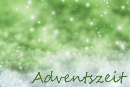 advent season: German Text Adventszeit Means Advent Season. Green Sparkling Christmas Background Or Texture With Snow. Copy Space For Your Text Here