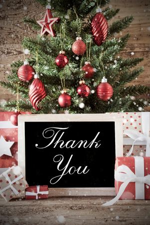 nostalgic christmas: Nostalgic Christmas Card For Seasons Greetings. Christmas Tree With Balls. Gifts Or Presents In The Front Of Wooden Background. Chalkboard With English Text Thank You