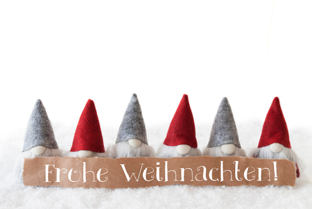 weihnachten: Label With German Text Frohe Weihnachten Means Merry Christmas. Christmas Greeting Card With Gnomes. Isolated White Background With Snow. Stock Photo