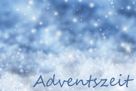 advent season: German Text Adventszeit Means Advent Season. Blue Sparkling Christmas Background Or Texture With Snow. Copy Space For Your Text Here