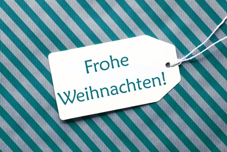 weihnachten: One Label On A Turquoise Striped Wrapping Paper. Textured Background. Tag With Ribbon. German Text Frohe Weihnachten Means Merry Christmas