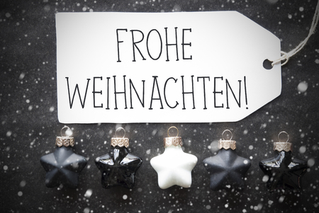 weihnachten: Label With German Text Frohe Weihnachten Means Merry Christmas. Black And White Christmas Tree Balls On Black Paper Background With Snowflakes. Christmas Decoration Or Texture. Flat Lay View