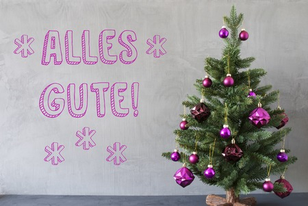 best wishes: Christmas Tree With Purple Christmas Tree Balls. Card For Seasons Greetings. Gray Cement Or Concrete Wall For Urban, Modern Industrial Styl. German Text Alles Gute Means Best Wishes Stock Photo