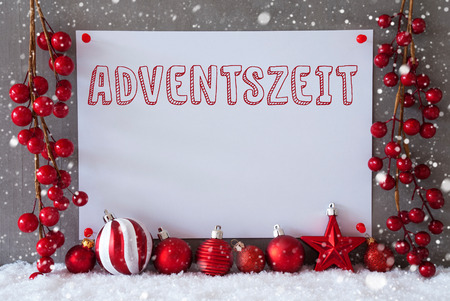 advent season: Label With German Text Adventszeit Means Advent Season. Red Christmas Decoration Like Balls On Snow. Urban And Modern Cement Wall As Background With Snowflakes.