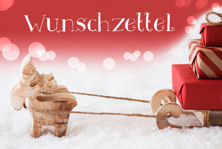 wish  list: Moose Is Drawing A Sled With Red Gifts Or Presents In Snow. Christmas Card For Seasons Greetings. Red Christmassy Background With Bokeh Effect. German Text Wunschzettel Means Wish List